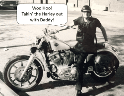 Ziggy takin' the Harley out with Daddy